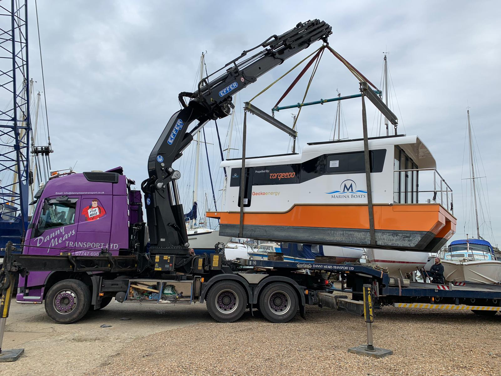 Marina boat being transferred on a crane