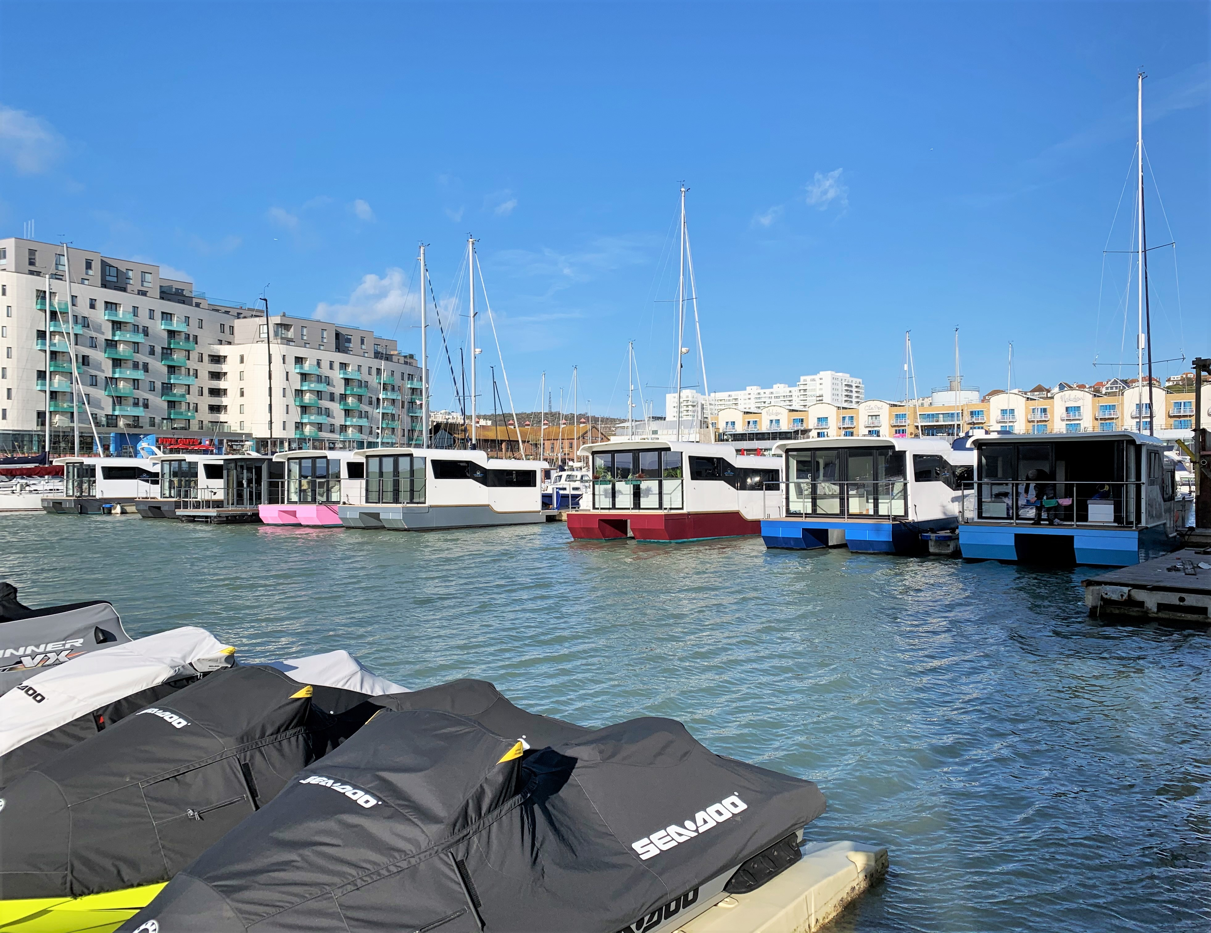 Marina boats with different coloured hulls